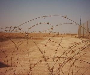 http://www.spacedaily.com/images-lg/iran-iraq-border-barbed-wire-lg.jpg